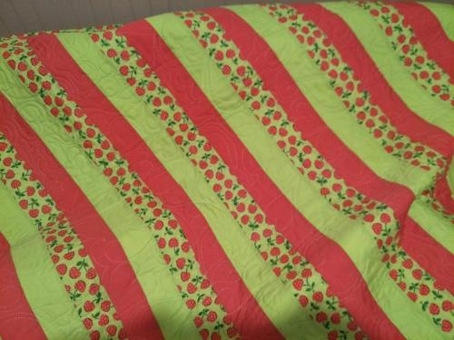 Green & pink cherry cot size 108cm x 126cm $120.00