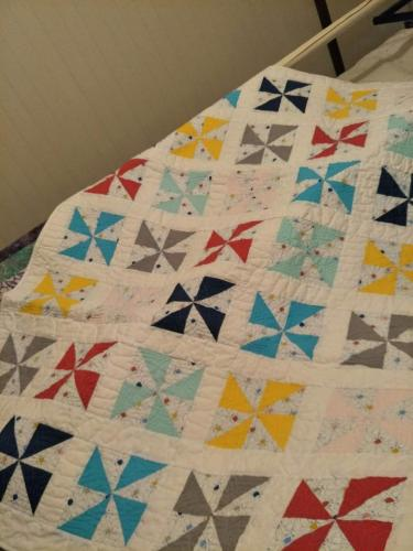 Colourful pinwheel cot size. $120.00